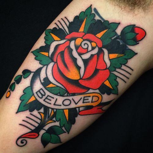 Super clean cover up tattoo by Josh Bovender #JoshBovender #flowertattoos #traditional #color #rose #rosebud #flower #floral #banner #text #quote #beloved #love #leaves #nature