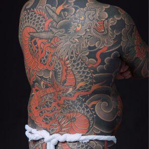 Dragon protector by Bunshin Horitoshi #BunshinHoritoshi #Japanese #dragon #fire #clouds #color #scales #horns #chrysanthemum #blackandgrey #tattoooftheday