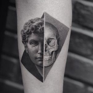 Portrait tattoo by Cold Gray #ColdGray #besttattoos #blackandgrey #realism #realistic #sculpture #Greek #Roman #skull #death #portrait #face #abstract #face #shapes #tattoooftheday