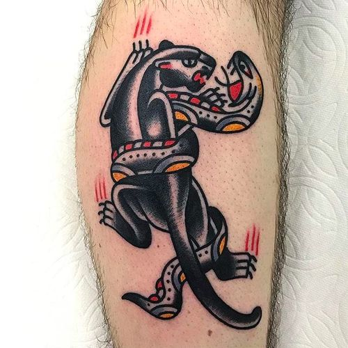 Panther battlin' a snake. Classic awesome work by Joshua Marks. #JoshuaMarks #ETS #traditionaltattoos #boldtattoos #classic #panther #snake