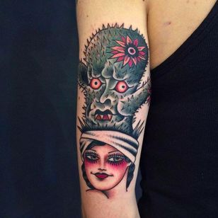 Awesome girl head with a cactus monster plant on her head. Insane tattoo by Anem. #Anem #traditionaltattoo #girl #girltattoo #cactus #traditional #traditionalgirl #girlhead