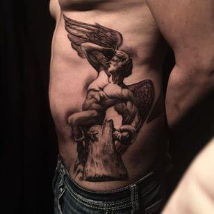 High contrast black and grey fallen angel tattoo by Miguel Camarillo. #blackandgrey #realism #MiguelCamarillo #angel #fallenangel