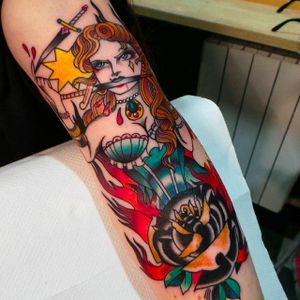 Awesome sword-handling girl tattoo by Eddie Czaicki. And check out that awesome black rose! #eddieczaicki #girltattoo #swords #blackrose #traditionaltattoo