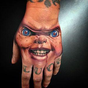 The look of evil. Chucky tattoo by Wes Hogan. #Chucky #ChildsPlay #horror #doll #handtattoo #realism #colorrealism #WesHogan