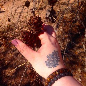 Cute pinecone tattoo by Doug Life Tattoo