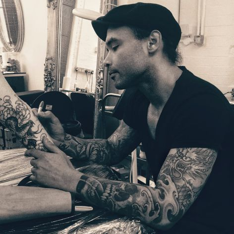 Joao Bosco free-hands part of a sleeve in-progress. Parliament Tattoo, London. Photo by Jessica Paige. #JoaoBosco #ParliamentTattoo #London #tattooartist