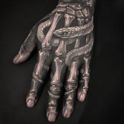 Hand tattoo by Gara #Gara #handtattoos #blackandgrey #skeleton #bones #death #snake #reptile #scales #blackfill #whiteink #anatomy