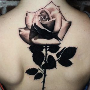 Rose tattoo by R17 #R17 #coveruptattoos #blackandgrey #blackfill #rose #realism #realistic #flower #leaves #thorns #nature #tattoooftheday