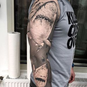 Black and grey shark sleeve looking scary as fuck, by Cigla. (via IG—ciglatattoo) #TattooRoundUp #Sleeves #Realism #blackandgrey #Sharks #Ocean