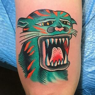 This one reminds us of He-Man's sidekick Battle Cat (or really, Cringer). (Via IG - chuckdenise_tattoo)