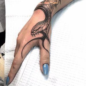 Snake bite by Joao Bosco #JoaoBosco #newschool #newtraditional #snake #scales #fangs #tongue #blackandgrey #reptile #tattoooftheday