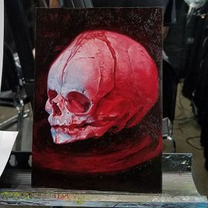 A crimson painting of a baby's skull via Christian Perez (IG—christian1perez). #babyskull #ChristianPerez #fineart #oilpaintings #skulls