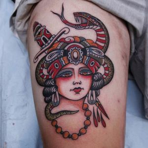A gorgeous lady head wit a dagger piercing a venomous snake by Vic James (IG—vic_james_). #dagger #ladyhead #snake #traditional #VicJames