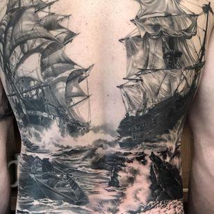 Backpiece tattoo by Kari Barba #KariBarba #landscapetattoos #blackandgrey #ocean #ships #boat #waves #realism #realistic #hyperrealism #sails #shipwreck #rocks