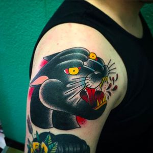 Super cool panther head tattoo done by Tom Lortie. #TomLortie #traditionaltattoo #coloredtattoo #pantherhead  #blackpanther