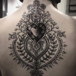 Heart gem and filigree tattoo by Alex Bawn #AlexBawn #jeweltattoos #blackandgrey #realism #realistic #folktraditional #ornamental #heart #gem #jewel #crystal #love #pattern #floral #leaves #vines #tattoooftheday