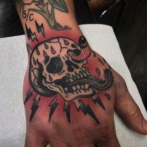 Wild skull tattoo by Ross Nagle #RossNagle #skulltattoos #traditional #color #oldschool #skull #tongue #eyeball #lightning #LightningBolt #blood #death #surreal #tattoooftheday