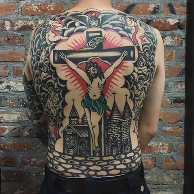 Jesus tattoo by Joshua Marks #JoshuaMarks #religioustattoo #blackandgrey #color #Jesus #cross #blood #banner #clouds #cherubs #angels #angelwings #castle #cross #landscape #light #star #traditional #backpiece #tattoooftheday