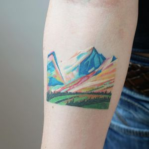 Watercolor mountain tattoo by Jess Chen #JessChen #landscapetattoo #watercolor #color #mountains #landscape #land #forest