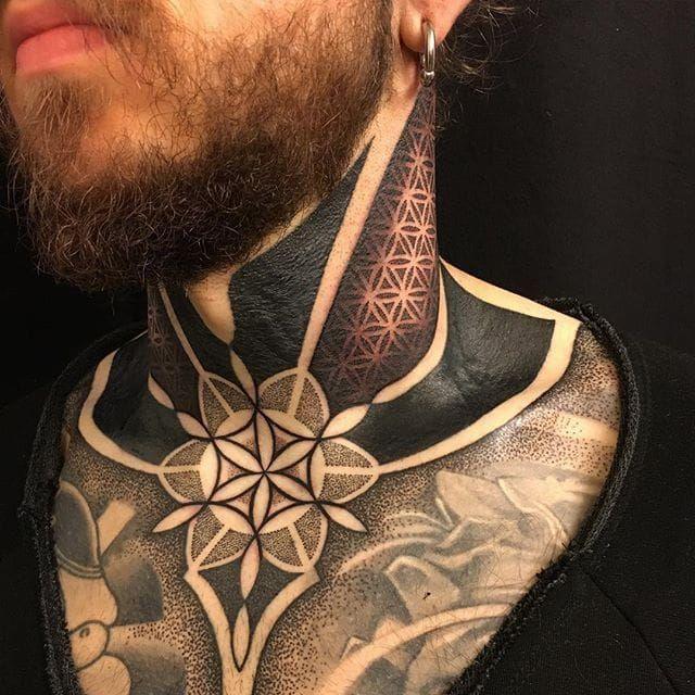 Geometric blackwork neck and chest tattoo by Gerhard Wiesbeck @gerhardwiesbeck #geometric #blackwork #dotwork #mandala #gerhardwiesbeck