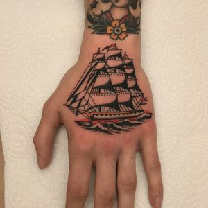 King of the sea tattoo by Vince Pages #VincePages #handtattoos #color #traditional #ship #ocean #boat #sails #sea #flags #sailor #maritime #travel #tattoooftheday