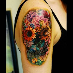 Color realism flower skull tattoo by Justin Buduo. #realism #colorrealism #JustinBuduo #flowers #skull