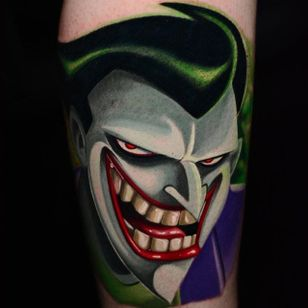 The Joker tattoo by Ben Ochoa. #BenOchoa #colorrealism #popculture #thejoker #joker #dc #villain #cartoon