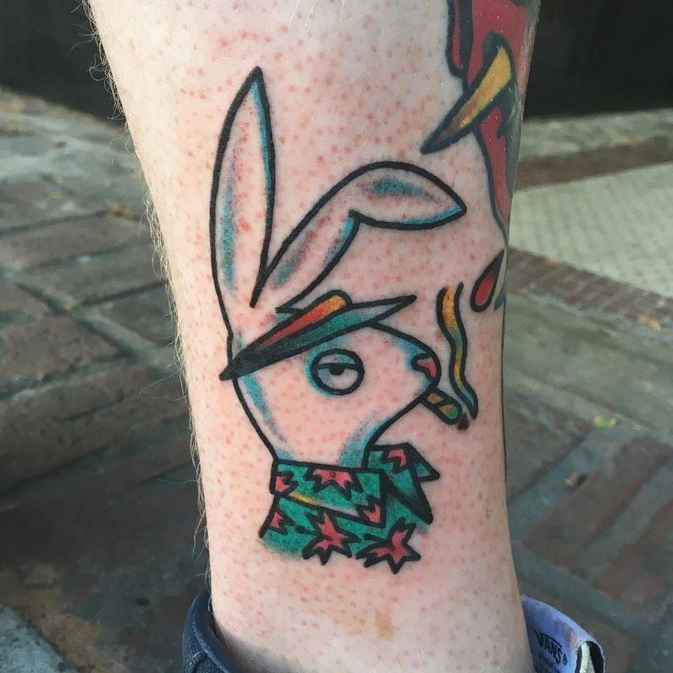 Hip bunny tattoo by Shane Nesmith #ShaneNesmith #weedtattoos #color #traditional #playboy #playboybunny #bunny #rabbit #animal #stoner #smoking #smoke #joint #marijuana #hawaiianshirt #tattoooftheday