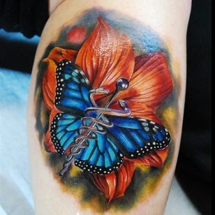 A realistic butterfly with a caduceus for a body by Justin Buduo (IG—artofbuduo). #butterfly #caduceus #color #JustinBuduo #realism #TheStaffofHermes