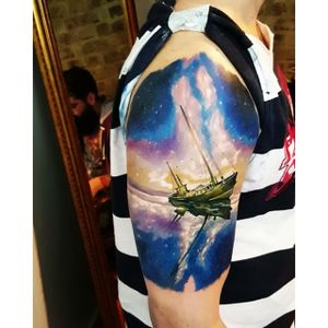 Stunning space-sail themed tattoo by Kobay Kronik. #realism #colorrealism #space #ship #KobayKronik