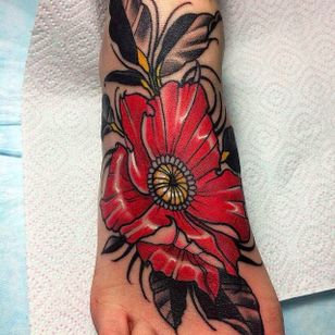 Beautiful, solid and vibrant foot flower tattoo by Evgenia Sin. #EvgeniaSin #neotraditional #coloredtattoo #foottattoo #flower #blossom