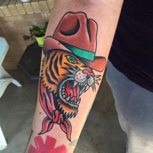 Cowboy tiger tattoo by Randy Conner. #traditional #RandyConner #tiger #cowboy #tattooflash #flashtattoo