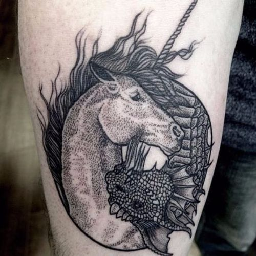 Beautiful delicate dotwork on the unicorn and dragon. Photo from Matina Marinou on Instagram #MatinaMarinou #blackworker #pointillism #dotwork #blackandgrey #woodcut #etching #engraving #dragon #unicorn