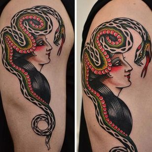 One of Florian Santus' wonderful lady heads with a snake (IG—floriansantus). #FlorianSantus #ladyheads #snake #traditional