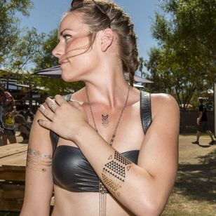Metallic temporary tattoos were THE trend this year at Coachella, photo by Shane Lopes for LA Weekly #coachella #festival #tattoostyle #fashion #flashtattoo #temporarytattoo