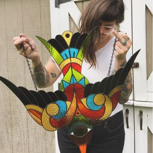Gina Ferrara holding the stained glass piece commissioned by Mario Desa (IG—oxbowglass). #bird #fineart #GinaFerrara #MarioDesa #oxbowglass #stainedglass
