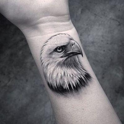 Eye of an eagle. (via IG - lazerliz) #tinytattoo #smalltattoo #portrait #animal #blackandgrey #microanimal #lazerliz #eagle
