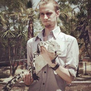 Aleksy Marcinow holding a crocodile (IG—aleksymarcinow). #AlekseyMarcinow #trippy #Unique