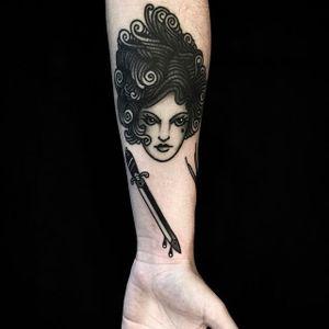Girl's head and sword tattoo done by Andre Albuquerque. Photo: @albvquerque #andrealbuquerque #girlhead #blacktraditional #black #sword