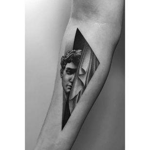 A beautiful male bust halfway concealed behind a curtain by Pawel Indulski (IG—dotyk.tattoo). #artistic #blackandgrey #dotwork #PawelIndulski #pointillism #statuesque #stippling