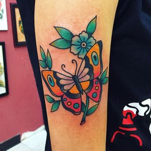 Traditional butterfly and flowers piece by Randy Conner. #traditional #RandyConner #tattooflash #flashtattoo #flowers #butterfly