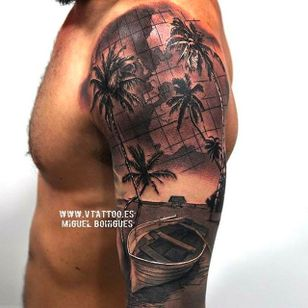 Incredible technique. You can tell a lot of Miguel's tattoo craftsmanship just by looking at photos of his work. #miguelangelbohigues #blackandgrey #beach #boat #palmtrees #islandlife