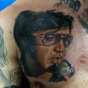 Tattoo by Dmitriy Samohin #DmitriySamohin #selftaughttattooartists #Elvis #realism #realistic #painterly #portrait #musictattoo #singer #famous #microphone #glasses #icon #ElvisPresley