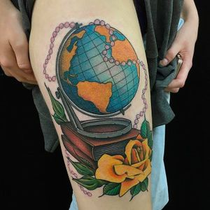 Super cool globe tattoo with a rose, a few books and some beads. Amazing tattoo by Dan Hartley. #DanHartley #TripleSixStudios #NeoTraditional #globe #rose #books