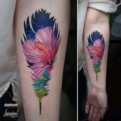 A flower scene inside of a detailed feather shape, by Andrey Lukovnikov. (via IG—lukovnikovtattoo) #neotraditional #color #silhouette #ukraine #AndreyLukovnikov