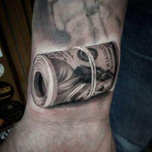 A fat roll of Benjamins! Awesome tattoo by Anastasia Forman. #AnastasiaForman #realistic #blackandgray #money #$$$