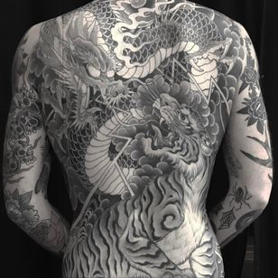 Dragon versus Tiger tattoo by Chris Garver #ChrisGarver #dragontattoos #Japanese #blackandgrey #dragon #tiger #junglecat #scales #fire #lightning #clouds #fight #battle #warrior