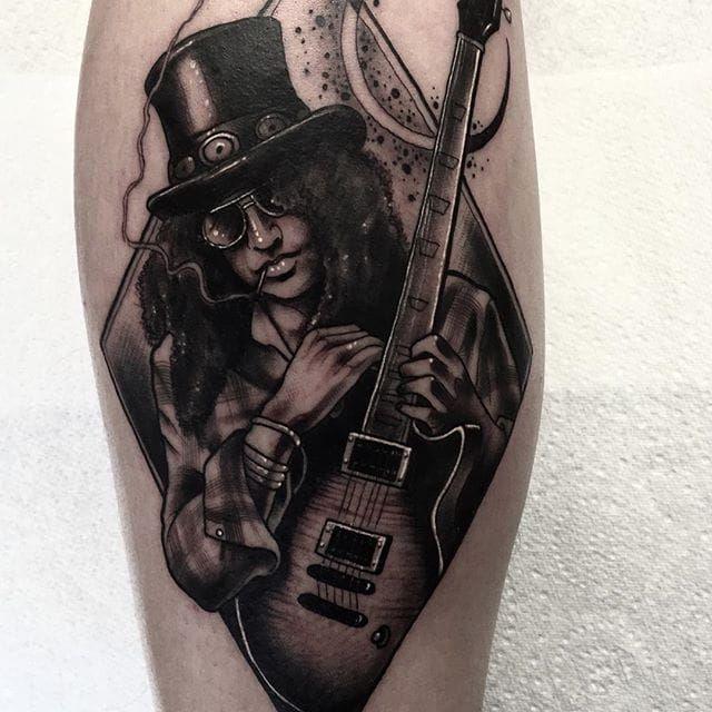 Guitar god Slash by Neil Dransfield (IG—neil_dransfield_tattoo). #black #dark #NeilDransfield #neotraditional #portraitrue #slash