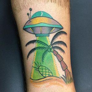 UFO Tattoo by Nick Stambaugh #ufo #ufotattoo #traditonal #traditionaltattoo #brighttattoos #neon #neontattoo #colorful #quirky #creativetattoos #NickStambaugh
