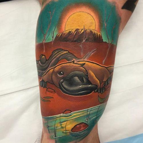 Bold new school platypus and desert scene tattoo by Henri Middlemass. #platypus #monotreme #australiananimal #newschool #desert #australia #HenriMiddlemass